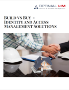 shaking hands over a table with a house and white hard hat