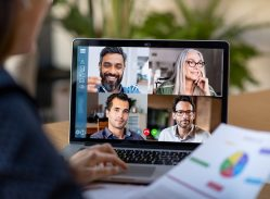 Four co-workers on a video chat business call